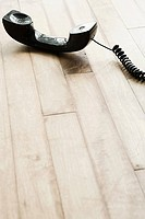 A telephone on a wooden floor