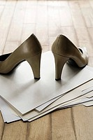 High heeled shoes on top of files