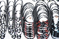 High angle view of necklaces at a market stall
