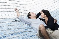 Mid adult couple lying in a hammock