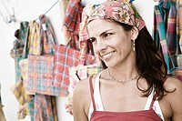 Close-up of a mid adult woman at a market stall and smiling