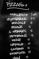 Close-up of a menu list on a blackboard