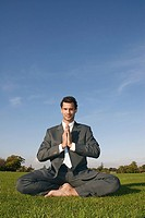 A businessman doing yoga