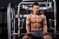 a man using fitness equipment