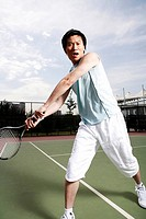 Portrait of young man playing tennis