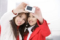 Young women taking pictures themselves