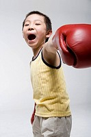 a boy practicing boxing