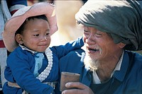 Elderly Lisu man carrying boy