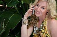 Woman smiling using a cell phone