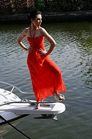 Woman posing on the bow of a boat