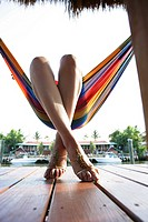 Legs of a woman lying in a hammock