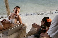 Young women getting massages at beach
