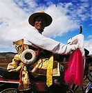 A portrait of a Tibetan man riding motorbike