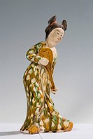 Three-color-glaze Tang porcelain of tomb figure playing lute Tang Dynasty