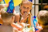 Boys and girls celebrating birthday party