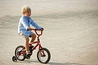 Boy riding cycle at the beach