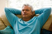 Mature man sitting on a couch