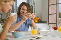 Young couple at breakfast table