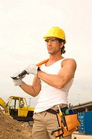 Male construction worker holding a bolt cutter