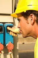 Close_up of a male dock worker operating a machine