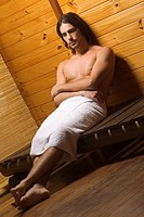 Young man having a sauna