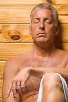 Close_up of a mature man with his eyes closed in a sauna