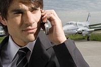 Close-up of a businessman talking on a mobile phone (thumbnail)