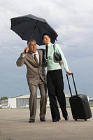 Businessman and a businesswoman walking at an airport