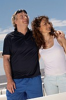 Mature adult couple relaxing on boat