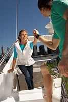 Young couple standing on boat (thumbnail)