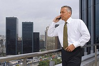 Mature businessman on the phone outdoors