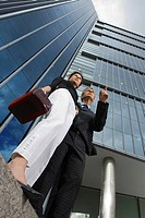 Low angle view of businesspeople standing in front of building