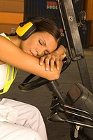 Mid adult woman taking a nap in a forklift