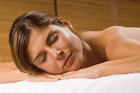 Close_up of a young woman lying on a massage table