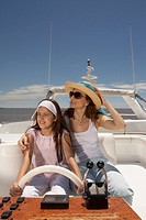 Mother and daughter relaxing on boat