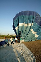 Deflation of the balloon on the landing site by the ground crew