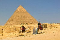 Tourists visiting the pyramids on dromedaries