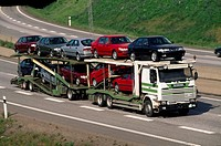 A truck with loaded cars