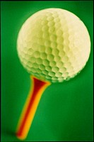 A golf ball on a tee