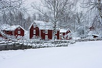 Houses on a snow covered landscape, Smaland, Sweden