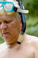 Man age 63 wearing snorkeling equipment  Danbury Wisconsin USA