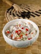 Raw, marinated fish in a small bowl