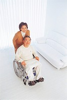 Man Sitting In Wheelchair With Woman,Korean
