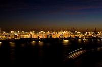 Buildings at harbor lit up at night, Hamburg Harbor, Hamburg, Germany