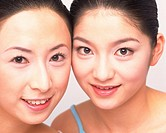 Closed Up Image of Two Rouged Mid Adult Women, Looking at Camera, Smiling