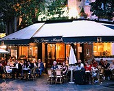 Chair Table People Lighted Tree Window Evening View, Cafe  Deux Magots Paris France