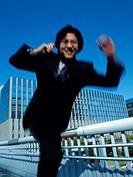 Businessman running and jumping, Blurred Motion