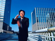 Businessman holding mobile Phone and running , Blurred Motion