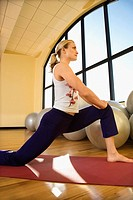 Caucasian Adult female stretching at gym