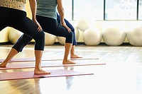 Caucasian Adult females in yoga class